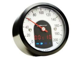 Side view of the face of the Motogadget Motoscope Tiny Gauge with black bezel.