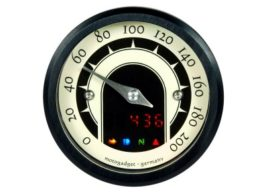 The image shows a front view of the Motogadget MST Speedster Gauge with lights on.